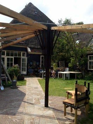 Garden with umbrella made from renovation leftovers Home Improvement