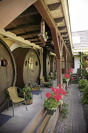 Wine barrel hotel in wood architecture  with Wood Wine hotel