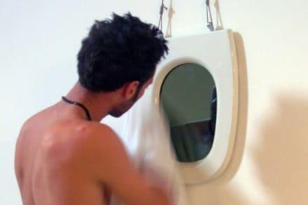 Toilet seat mirror
