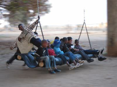 Gravity passengers in tyre inner tube social metals  with Tire swing Africa