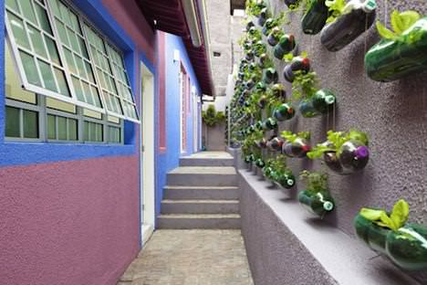 vertical garden bottles sao paulo 1 Plastic bottles garden in social plastics packagings diy architecture  with Plastic Garden Bottle