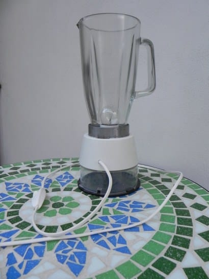 Lamp with a blender and round containers for CDs