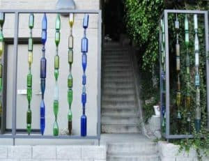 Garden fence with recycled bottles
