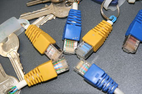 Colorful key chain and rack in electronics  with plug Key
