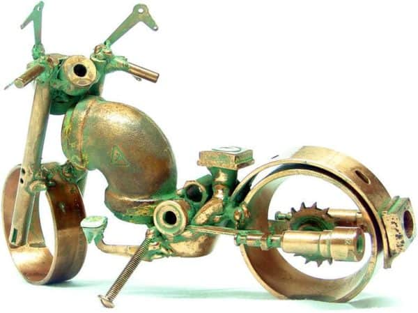 Sculptor concerned about the sustainability in art  with Sculpture Recycled Art Motorcycle Metal