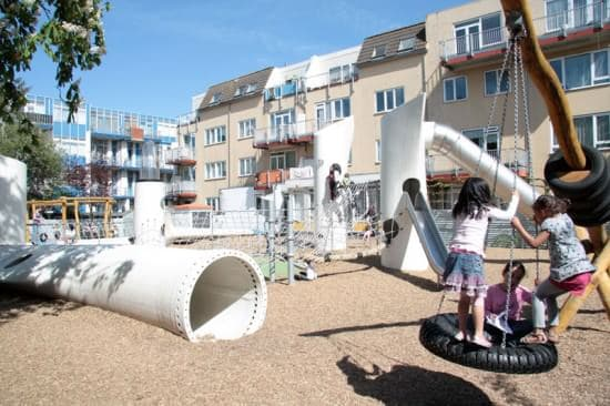 Playground with used windmill parts in social metals architecture  with wing windmill playground Kid