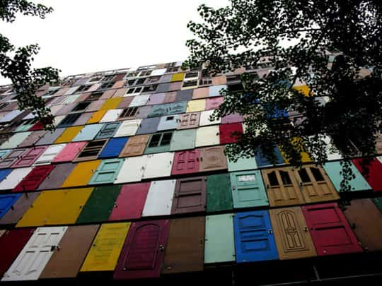 1000 doors for 1 recycled facade in wood social art architecture  with urban Door city
