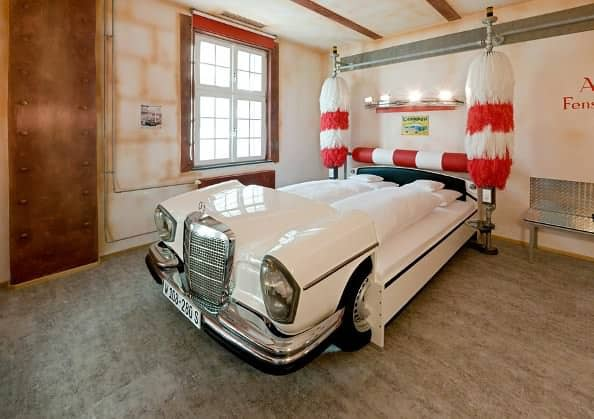 V8 Hotel Themenzimmer CarWash 00 Hoppe Cars repurposed as beds in social architecture  with Room hotel Automotive
