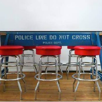 """Police Line Do Not Cross"" Barrier Recycled Into Table"