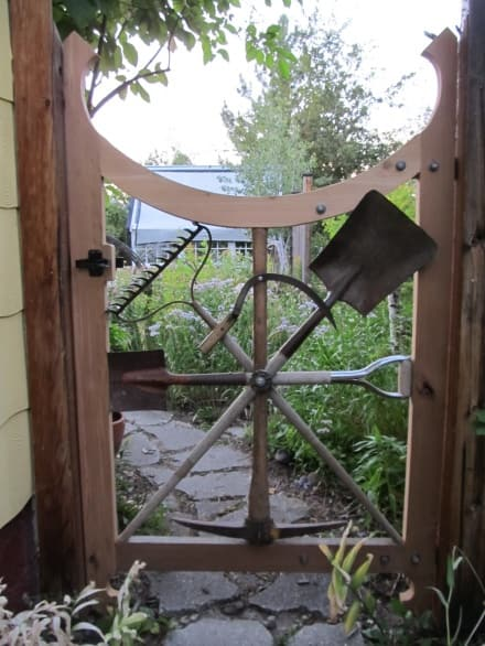 Garden gate with repurposed garden tools