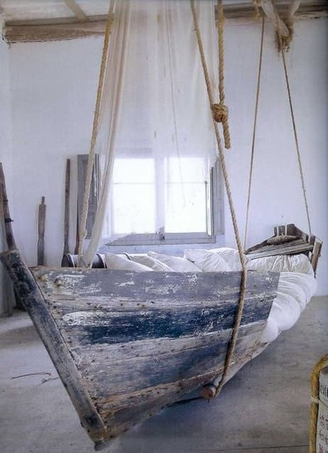 Upcycled boat bed in wood architecture  with boat Bed
