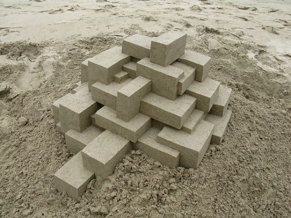 Geometric sandcastles by Calvin Seibert in wood social diy art  with summer sand Beach