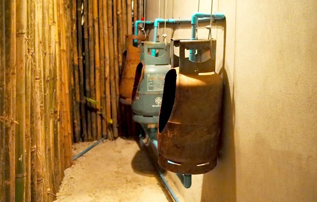 Urinal from repurposed gaz bottles in social metals diy architecture  with WC tank gaz Bottle