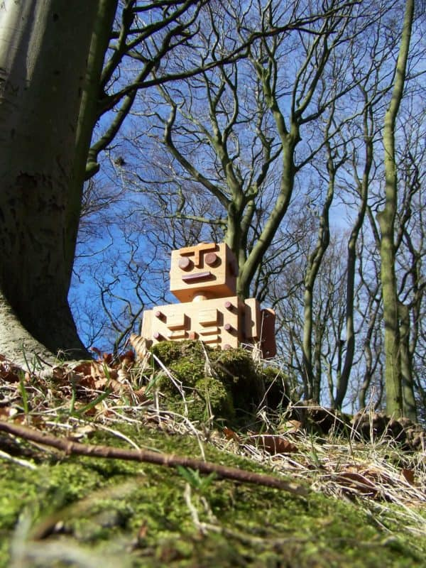 Natures Woodbots are rising from the leaves in wood art  with woodbot Wood Toy Robot Handcrafted Craft