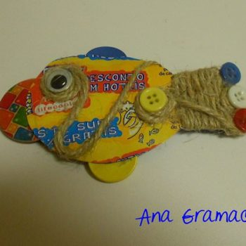 Can fish brooch