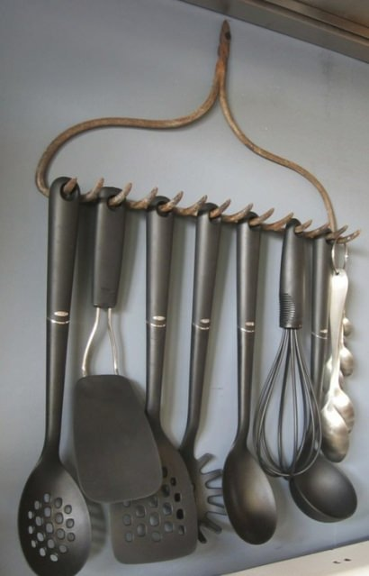 Old rake recycled into kitchen accessories holder