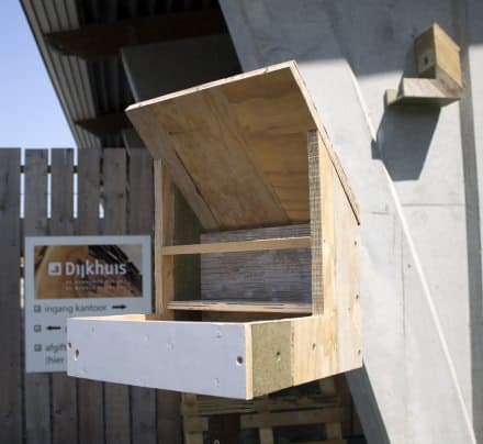 Birdhouses made from old construction materials