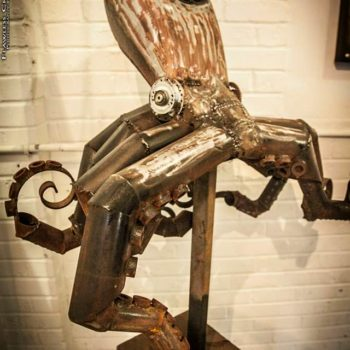 Octopus tank sculpture from repurposed motor bike tank