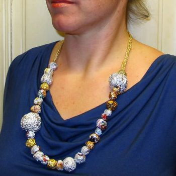 Necklace from aluminum foil, candy wrapper balls, globes and spheres