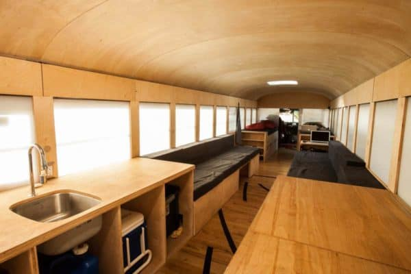 School bus repurposed into a mobile home in architecture  with