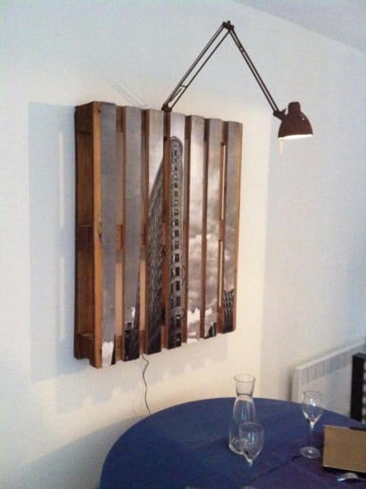 Repurposed pallet as a picture frame with lamp
