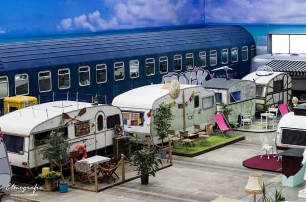 Industrial space transformed into vintage caravan hotel in social architecture  with hotel caravan