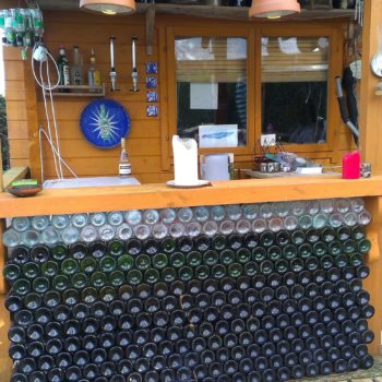 Bar Counter Made From Empty Glass Bottles
