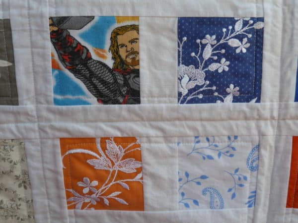 A familys treasured clothing made into a quilt for their new baby in fabric  with Recycled quilt Fabric