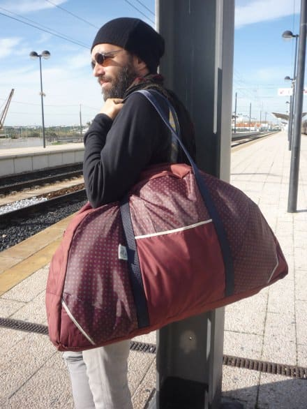 Umbrella upcycled into travel bag