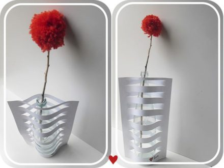 Vase made from glass bottle and paper