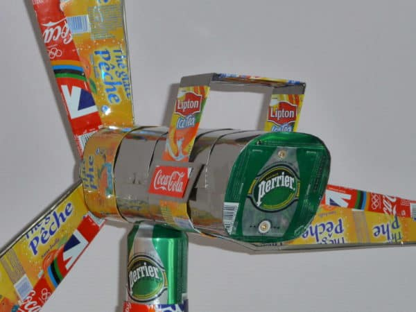 Wind turbine (5 feets) made with cans and other wastes in art packagings metals  with Recycled Handmade Corks Cans