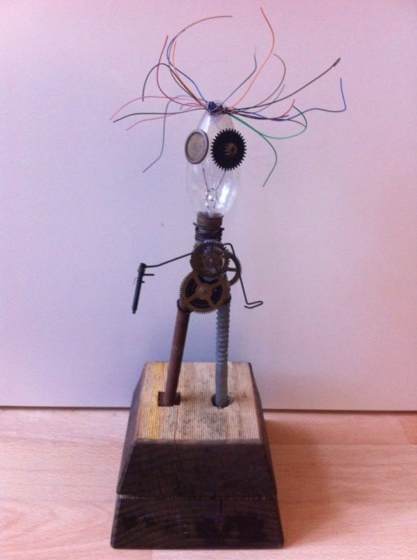 Edison Sculpture in art  with Wood Wire Sculpture Recycled Art