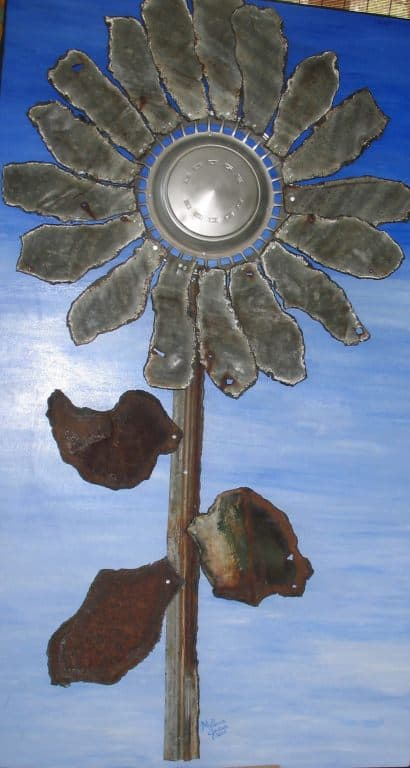 Recycled hubcap sunflower