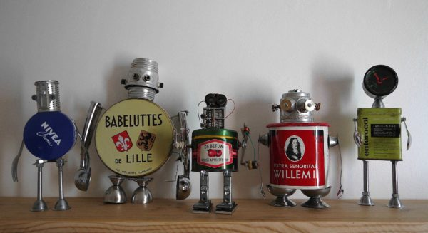Assemblage of junk robots in art metals  with Upcycled Sculpture Robots Reused Recycled Metal Junk Found objects Assemblage