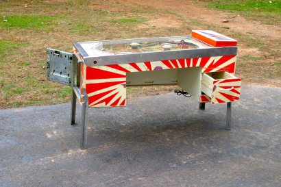 Recycled pinball machine into desk