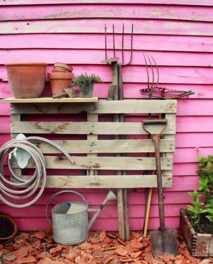 Pallet as a garden tools organizer