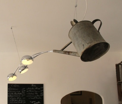 Watering can transformed into a chandelier