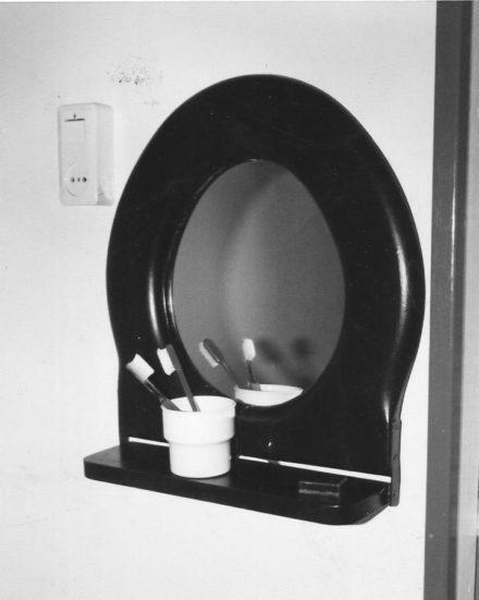 So simple: Toilet seat mirror :)