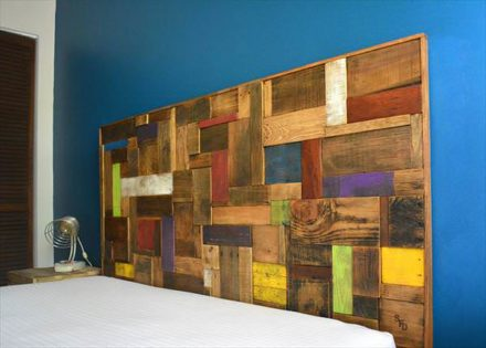 Colorful Headboard Made Out Of Recycled Pallets
