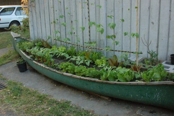 Planter Made From An Old Canoe Garden Ideas