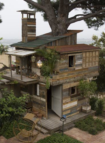 Houses From Discarded Pallets & Salvaged Materials