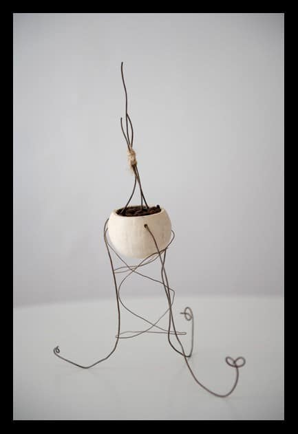 Ecological Artwork like this upcycled vase that is made by using an upcycled pot and bits of scrap wire.