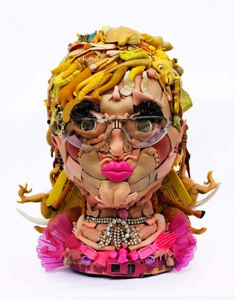 Humanoid Faces Made of Doll Parts Recycled Art