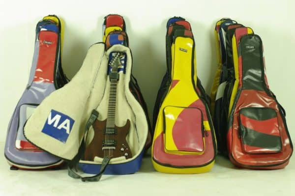 Upcycled Truck Tarps & Banners Into Guitar Case Accessories