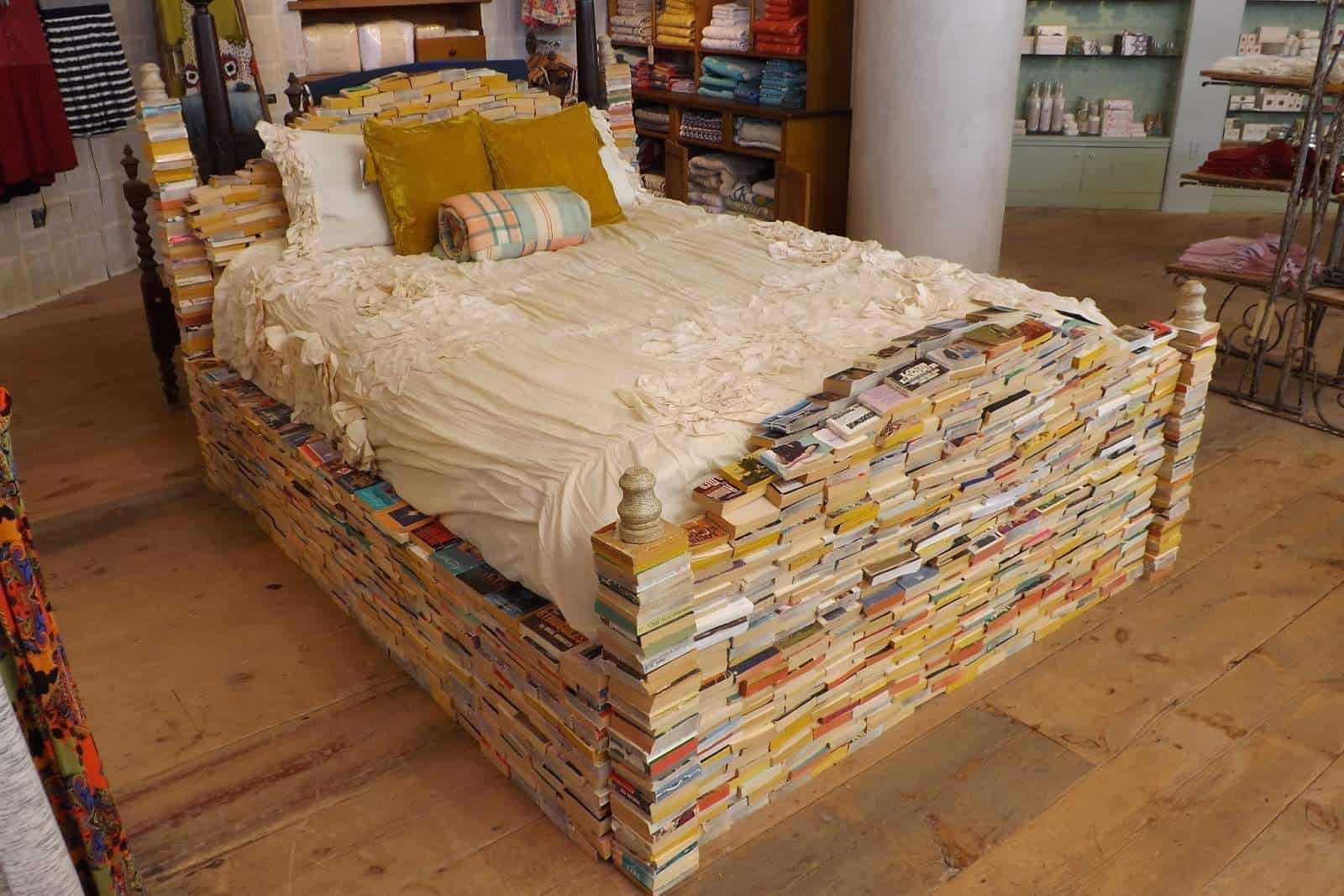 Books bedframe recyclart How to store books in a small bedroom