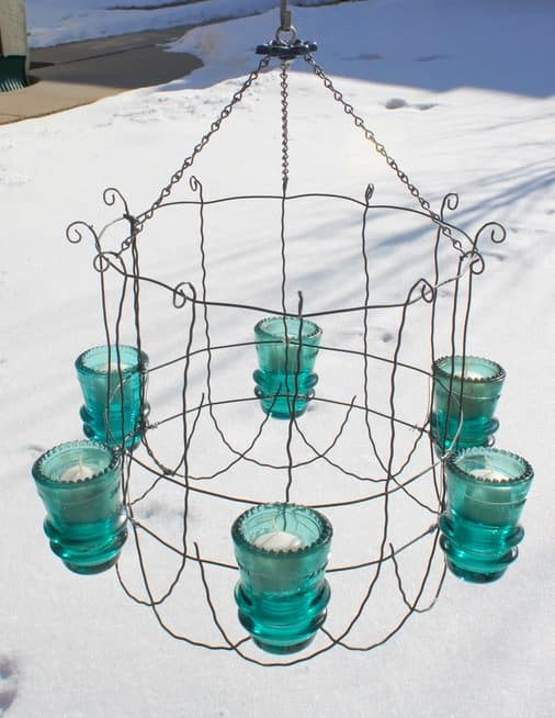 This delicate Vintage Glass Insulator chandelier is unique and turns heavy, thick, insulators into an airy piece of hanging art!