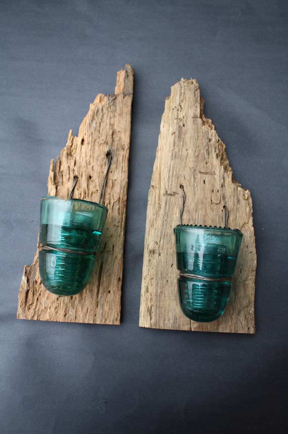 Vintage Glass insulators and wormy wood becomes a beautiful rustic set of candle holders.