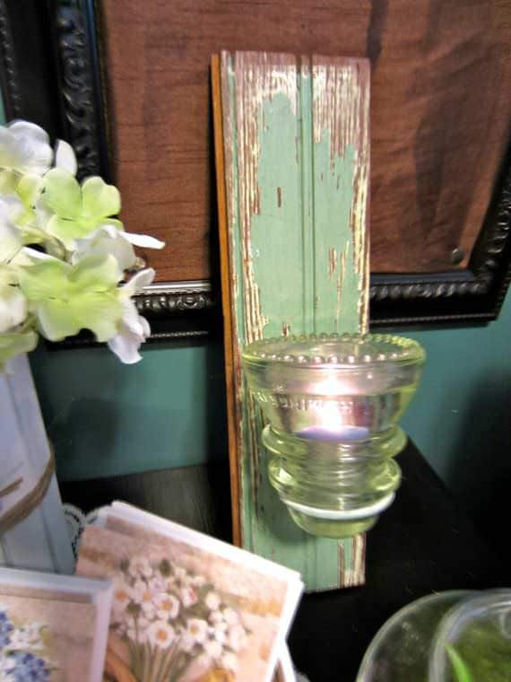 Attach a Vintage Glass Insulator to a piece of upcycled wood for a beautiful rustic candle holder!