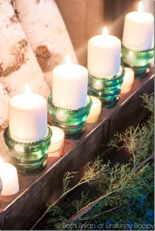Turn old industrial Vintage Glass Insulators into elegant party lights or tea light centerpieces - or mantle pieces with this gorgeous idea.
