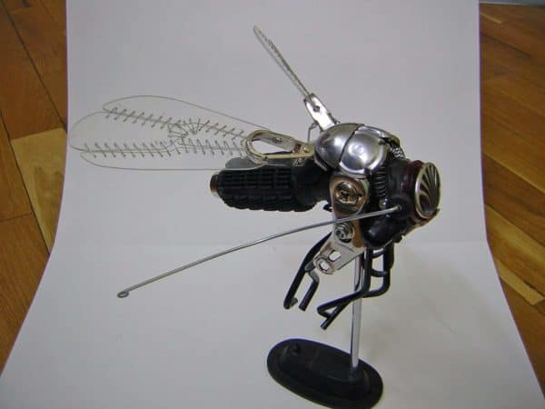 Scrap Into Fly Recycled Art